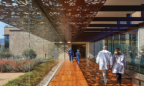Healthcare staff performance and job satisfaction are positively impacted when views to features like outdoor gardens are incorporated into the design. Walkway at Palo Alto Medical Foundation, San Carlos Center - NBBJ
