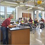 Link to larger image classroom, teacher, kids at tables